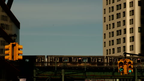 subway in long island city - elevated train stock videos & royalty-free footage
