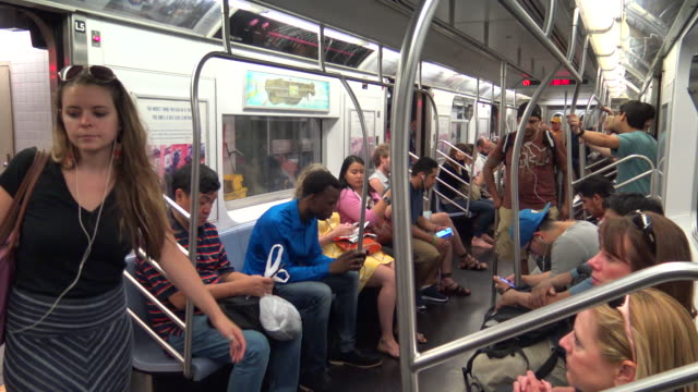 #7 subway interior, new york city - 34th street stock videos and b-roll footage