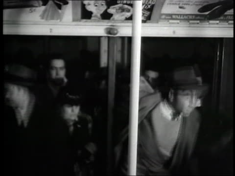 vídeos y material grabado en eventos de stock de subway passengers crowd through turnstiles and enter a train - 1940