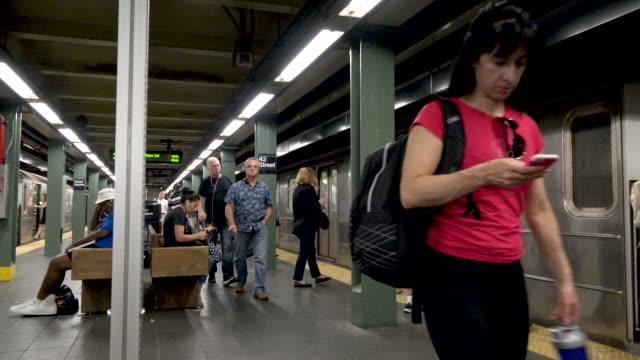 # 1, 2, 3, subway platform at times square - getting on stock videos & royalty-free footage