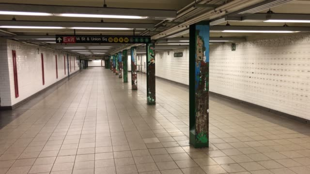 a subway station sits virtually empty at union square in manhattan on june 01 2020 in new york city amid the coronavirus pandemic demonstrations rage... - union square new york city stock videos & royalty-free footage