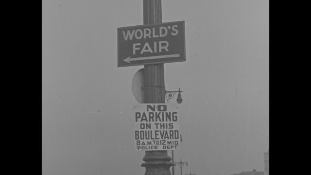 vs subway stop decoration of new york world's fair exhibits trylon and perisphere graphic sign of both on pole / world's fair no parking on this... - 1939 stock videos & royalty-free footage