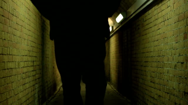subway stranger. back view, slow-mo. 7 seconds. - alley stock videos & royalty-free footage