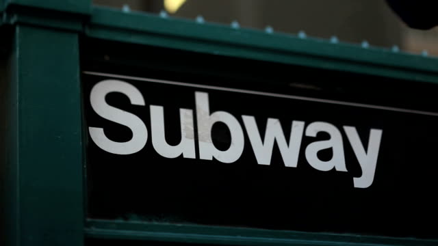 subway street station (tilt shift lens) - entrance sign stock videos & royalty-free footage