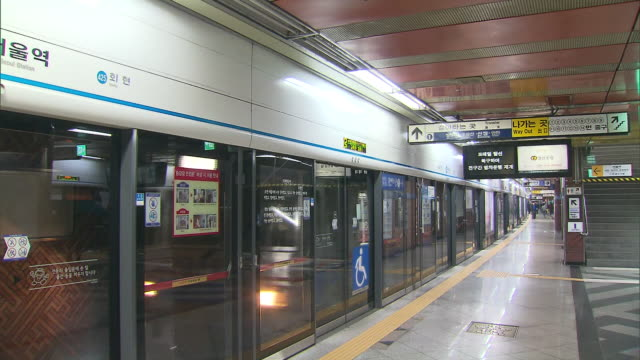 subway train approaches platform at seoul - south korea stock videos & royalty-free footage