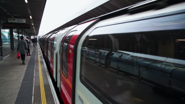 ms subway train arriving at platform of stratford station / london, england, united kingdom - uk stock videos & royalty-free footage