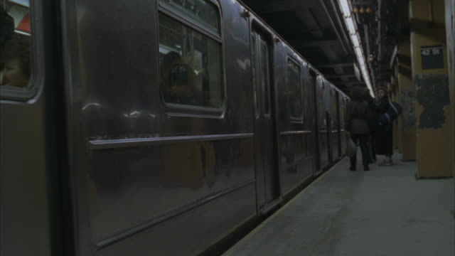 cu, pan, shaky,  subway train arriving at platform, passengers exiting and entering train - shaky stock videos & royalty-free footage
