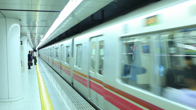 ws subway train arriving at station / tokyo, japan  - underground stock videos & royalty-free footage