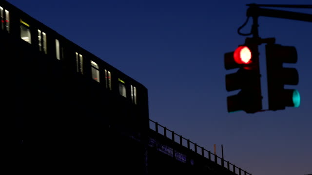subway train at dusk - traffic light stock videos & royalty-free footage
