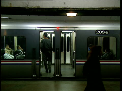 subway train doors people get off man gets on train pulls away - anno 1987 video stock e b–roll