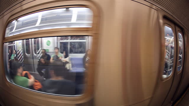 ws subway train enters the station   camera pans with train   then the train stops   fisheye lens - underground station platform stock videos & royalty-free footage