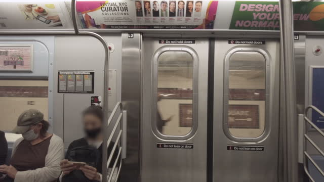 subway train interior on 34th street station. doors close and the train leaves the station in new york city, new york on june 17, 2021. people in the... - sitting stock videos & royalty-free footage