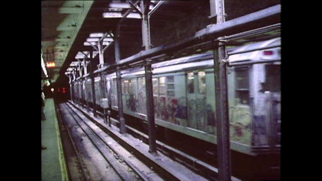 vídeos de stock e filmes b-roll de a subway train leaves the station in new york; 1976 - 1976