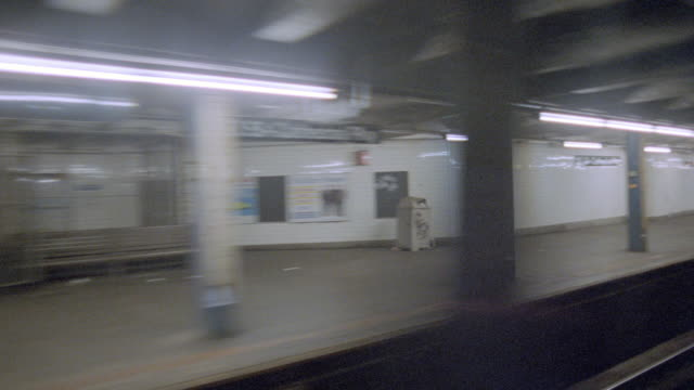 a subway train moves past the platform. - 1990 stock videos & royalty-free footage