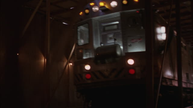 a subway train moves through an underground tunnel as shots are fired at it. - ambush stock videos and b-roll footage