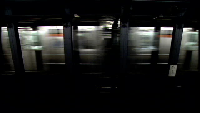 Subway Train Moving Through Subway Stations in NYC