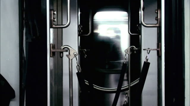 cu subway train passing behind roped off area between subway cars / new york city, new york, usa - roped off stock videos and b-roll footage