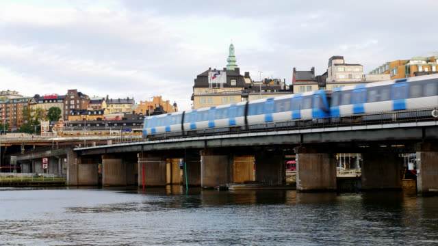 Subway train passing by over bridge