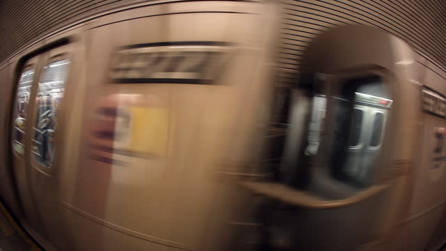 vidéos et rushes de ws subway train picks up speed  camera sees passengers through doors   windows  train leaves the station - wagon