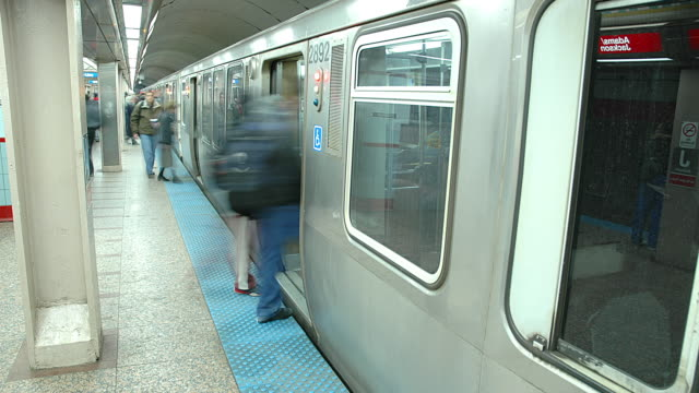 t/l subway train pulling into station  / chicago, illinois, usa - chicago 'l' stock videos & royalty-free footage
