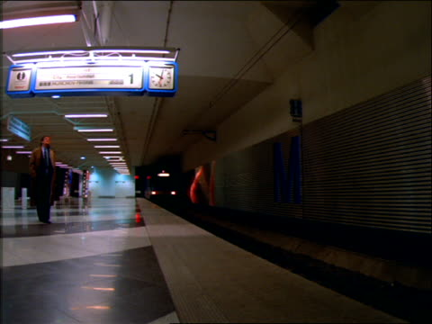 stockvideo's en b-roll-footage met subway train pulling into station / munich - 1992
