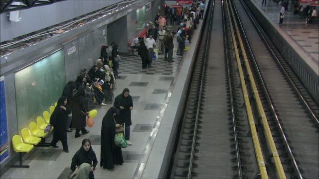 ms ha subway train pulling on station, tehran, iran - teheran video stock e b–roll