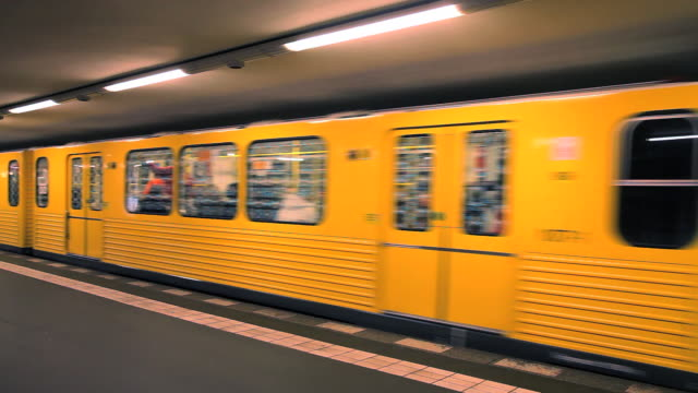 A subway train pulls away from an underground station in Berlin.