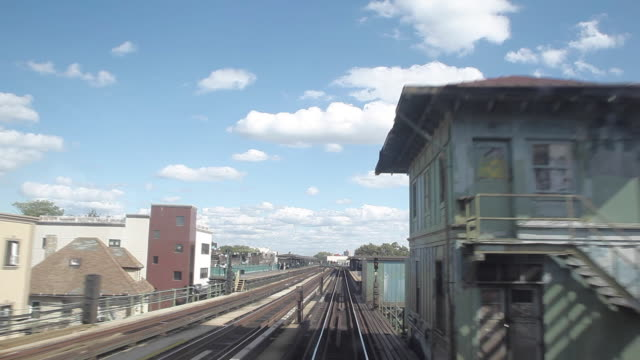 ny subway train running on rail track out of manhattan tunnel - elevated train stock videos & royalty-free footage