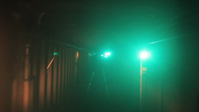 vídeos de stock, filmes e b-roll de a subway train speeds through green lights in a tunnel. - tunnel