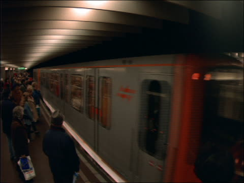 stockvideo's en b-roll-footage met subway train stops beside crowded platform / brussels - 1992