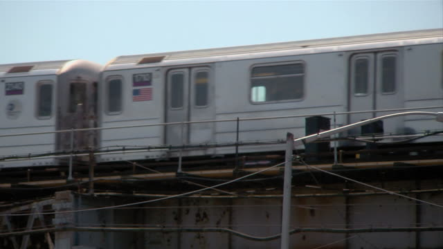 A subway train travels on elevated tracks.