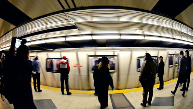 TTC subway trains and city commuters in Bloor-Yonge Station, Line 1