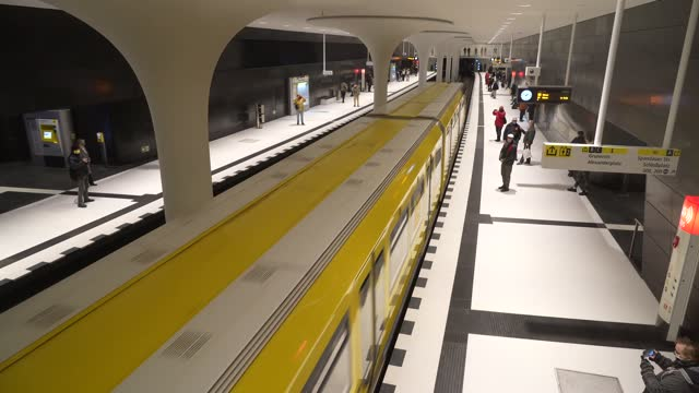 subway trains arrive and depart at rotes rathaus station on the new extension of the u5 line on the extension's opening day during the coronavirus... - rathaus bildbanksvideor och videomaterial från bakom kulisserna