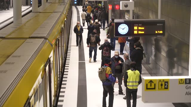 vídeos de stock e filmes b-roll de subway trains arrive and depart at rotes rathaus station on the new extension of the u5 line on the extension's opening day during the coronavirus... - rathaus