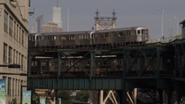 MS Subway trains on elevated tracks in Queens / New York City, New York