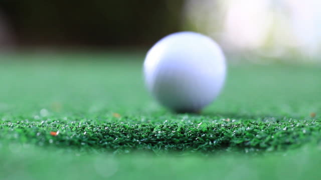 success golf putting - golf ball stock videos & royalty-free footage