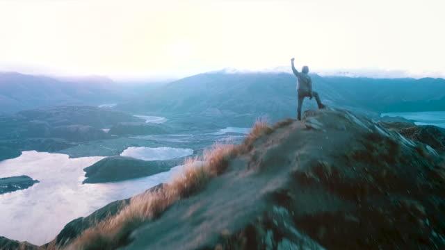 success man at top mountain - mountain peak stock videos & royalty-free footage