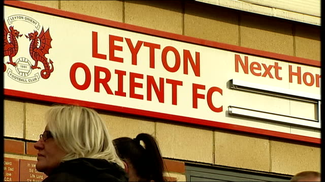 success of andros townsend in his england debut t12101324 / tx leyton brisbane road 'leyton orient football club' sign on wall fans outside brisbane... - leyton orient f.c stock videos and b-roll footage
