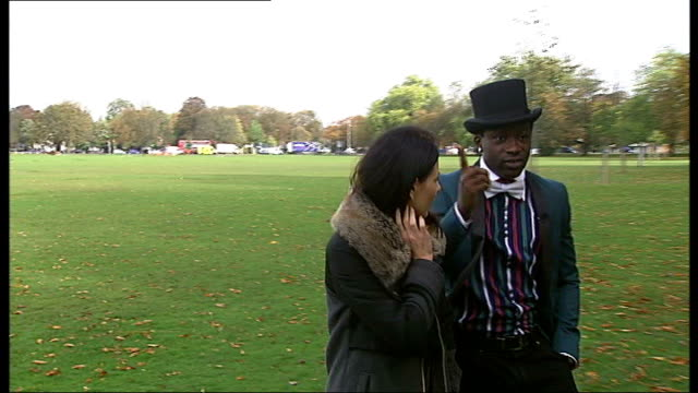 success of fashion designer and musician emmanuel nwani england london ealing ext reporter with emmanuel nwani known as emmanuel part of the fashion... - ealing stock videos and b-roll footage