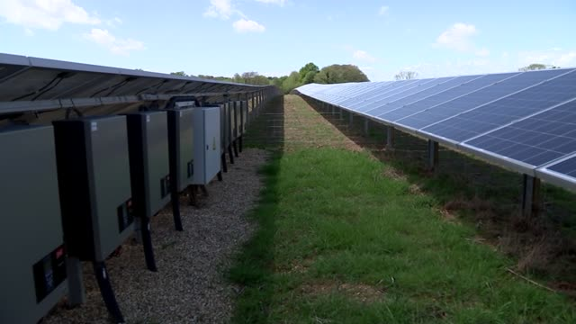 success of solar power energy as a renewable source england dorset ext sun shining in sky tilt down solat panels in field various shots solar panel... - ladder of success stock videos & royalty-free footage
