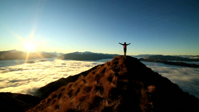 success on mountain summit - one young woman only stock videos & royalty-free footage