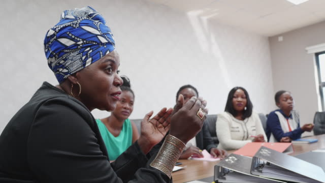 successful african businesswoman chairing a staff meeting - only women stock videos & royalty-free footage