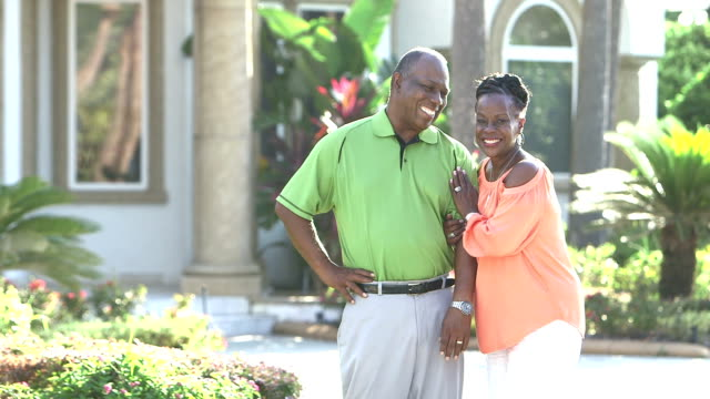 successful african-american couple at in front of house - davanti video stock e b–roll