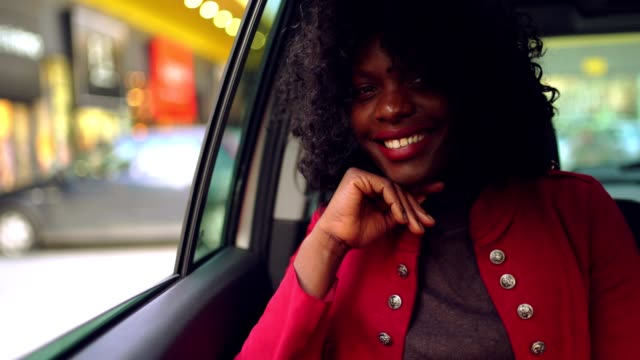 successful beautiful young business woman riding in back seat in the taxi - passenger seat stock videos & royalty-free footage