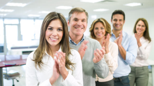 Successful business people applauding