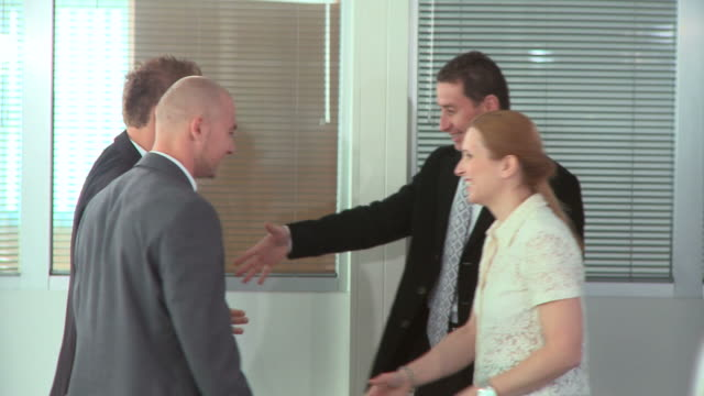 hd dolly: successful business - colleague hug stock videos & royalty-free footage