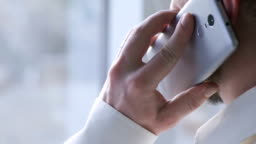 Successful businessman calling friend, using modern smartphone, communication
