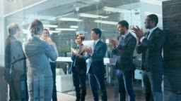 Successful Businessman Got Promotion and Makes Celebratory Dance, His Colleagues Applaud and Encourage Him.