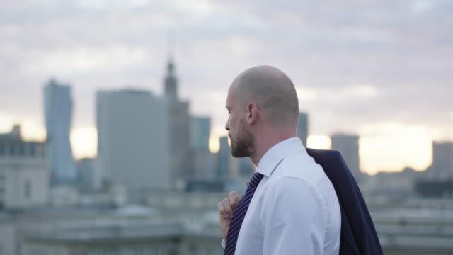 Successful businessman walking on roof.