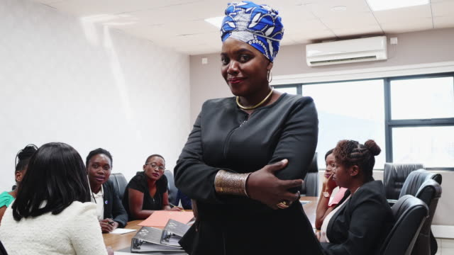 successful businesswoman standing at her boardroom - zambia stock videos & royalty-free footage